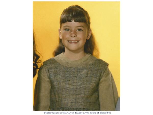 Debbie as Marta