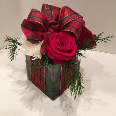Its a flower arrangement that looks like a gift!